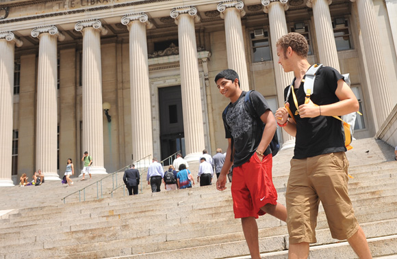 Students walking on campus descending stairs